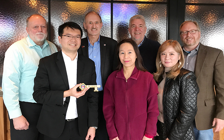Wang Receives Key To The Village